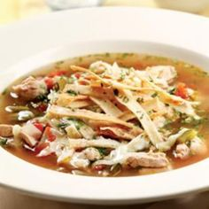 Here& a version of chicken tortilla soup that& both super-easy and delicious. To make it even quicker, use crumbled baked tortilla chips in place of the homemade tortilla strips and skip Steps Serve with vinegary coleslaw, lime wedges and hot sauce. Healthy Soup Recipes, Mexican Food Recipes, Dinner Recipes, Cooking Recipes, Ethnic Recipes, Dinner Ideas, Lunch Ideas, Healthy Foods, Mexican Entrees