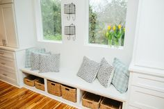 Sure, every Fixer Upper home is packed with style. It's also packed with function, especially in the entryway, where Joanna is sure to create space for families to store all the clutter that comes with kids. Got baseball gloves, soccer balls and backpacks? Assign each kid an under-bench cubby to keep the entryway organized and clutter-free.