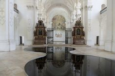 """Used Motor Oil Reflecting the Architectural Splendor of a Church Swiss artistRomain Crelier,created this visually appealing artwork installed on the floor of theBellelay Abbeyin Switzerland in 2013. The work is a classic and clever merging of two shallow pools of used motor oil functioning as mirrors, reflecting the architectural details of the surrounding interior. The artist referred to the piece as """"monochrome paintings using a despised substance."""" You can see more photos onWe Find…"""
