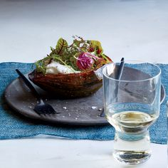 Food & Wine's satisfying vegetarian dish features sweet roasted squash drizzled with garlic butter and topped with melty cheese.