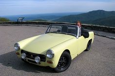 MG Midget with black Ros-style wheels looks good.