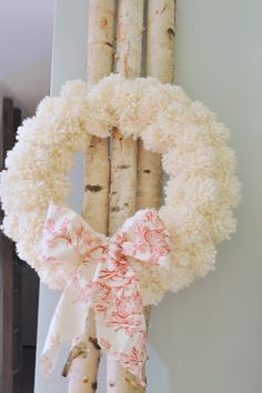 Restoration House: Anthro inspired pom pom wreath--wrap green foam wreath w/ribbon and use grays, creams, whites for winter