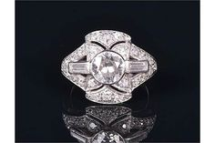 An Art Deco platinum and diamond ring centred with an old European cut diamond of approximately