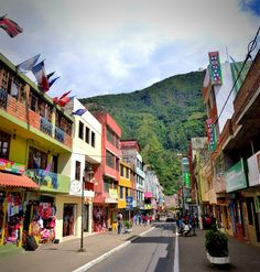 The colorful streets of Baños, Ecuador, nestled in a valley among the mountains.