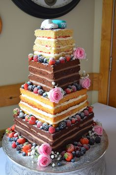 Square naked wedding cake with Beetle car and VW camper can toppers