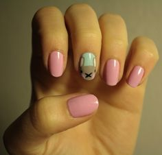 Today's Daily Nail Art is this cute design of a peeking bunny by glittersmack. Aww, look at it blush!