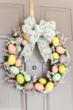 DIY Easter Egg Wreath - create a beautiful Spring wreath with easter eggs, moss, and flowers. Add a pink and mint floral bow and you have a pretty DIY Easter egg wreath to welcome guests. Easter Crafts For Adults, Easter Ideas, Easter Recipes, Diy Ostern, Diy Easter Decorations, Easter Wreaths Diy, Tree Decorations, Thanksgiving Decorations, Outdoor Easter Decorations