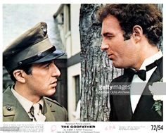 Al Pacino and James Caan having a conversation in a scene from the film 'The Godfather', 1972.