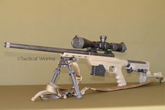 MDT's LSS Chassis in FDE. Savage model with ERGO F93 Pro Stock, AI .223 polymer magazine, and an Atlas Bipod.