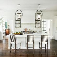 White Marble Top Island with Gray Spindle Counter Stools