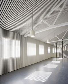 this would tie into the existing museum nicely and would play with the slat theme