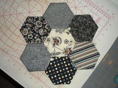 "Supplies  14 Charms (5"" Squares)  Batting Scraps (I used warm & natural)  Thread to match for topstitching  4"" hexagon template (I used th..."