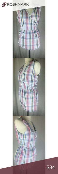 """London Country Blouse Beautiful plaid blouse that wraps around you robe style and ties in the back. Lots of ribbon for you to tie in multiple styles depending on preference. Found in a little market shop in London. Doesn't suit me the way I wanted, but it's too cute not to get some love.   Mannequin is size 2-4, her measurements are  33"""" 24"""" 34"""" Tops Blouses"""