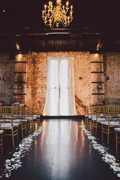 With tall brick walls and exposed beam ceilings, the ceremony and reception venue was the perfect location based on its beautiful interior alone. | Speakeasy Themed Industrial Wedding | Zorz Studios