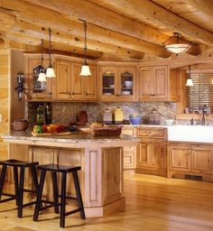 decoration witching log cabin kitchen chairs using vintage hanging ceiling lights above light granite countertops also antique gooseneck faucet on porcelain farmhouse sink Rustic Cabin Kitchens, Small Country Kitchens, Log Home Kitchens, Rustic Kitchen Design, Italian Kitchens, Elegant Kitchens, Rustic Cottage, Kitchen Designs, Log Cabin Homes