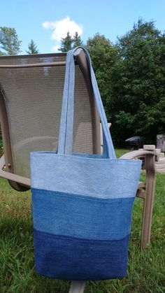 Both chic and practical, this tote is also eco friendly being made up of 5 different pairs of retired jeans. It is lined with a pretty blue calico cotton fabric. I have been testing the proto type I designed of this bag for 6 months now and its become my go to bag! The handles are 28 inches from end to end (14 inches at the highest point) which is long enough to wear on a shoulder but not too long so the bag drags on the ground (at 53 Im on the short side and it doesnt drag for me).  It…
