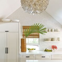 Love the tile going up to the ceiling in this Key West bungalow.  Pendant is fab too!