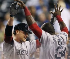 Game #28: Will Middlebrooks homered twice, David Ortiz and Dustin Pedroia also went deep, as the Sox beat the Royals 11-5 to end a 5 game losing streak. Middlebrooks hit a 3-run shot in the 1st and a 2 run homer in the 8th to become the 1st player in Sox history with at least 1 extra-base hit in each of his 1st 4 games.  Dubrount allowed 5 KC runs over 6 1/3 innings, giving the Red Sox bullpen a needed rest. That's 1 win in a row!  Pictured: Will Middlebrooks is congratulated by David Ortiz.