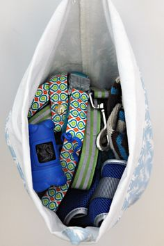 Keep Dog supplies in a hanging tote bag to keep everything in one place and out of sight - leashes, bags, brush, toys.