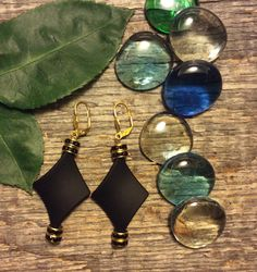 Jet black diamond shaped beads make these gold leverback earrings spectacular! Little gold rondelles with black Swarovski crystals add that sparkle too! Pretty designer clasp! Stunning with the matching necklace!!!