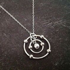 Silver Carbon Atom Necklace   23 Majestically Beautiful Pieces Of Science Jewelry