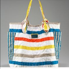 Authentic Marc tote Large multi stripe nylon Tate. Inside has Marc Jacob lining.  See picture. Inside back wall  zipper pocket. Outside pockets along the side gussets of the bag. 17 inches high by 17 inches wide. 8 1/2 inch drop on shoulder straps.  Never used. Marc by Marc Jacobs Bags Totes