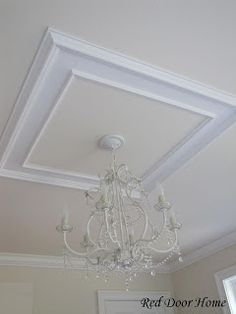 Remodelaholic | Add Character to Your Ceilings. Love this moulding framing the chandelier!