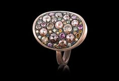 Starstruck ring set with pink, cognac and green diamonds