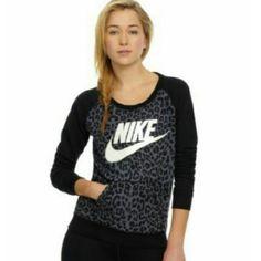Nike rally crew neck Nike sportswear rally crew neck cheetah print sweatshirt. Has front joey pocket. First photo is a stock photo. Nike Tops Sweatshirts & Hoodies