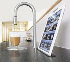 Scanomat - the new revolutionary luxury kitchen gadget! It's a tap that brews coffee, froths milk, or gives you chilled drinking water, cold milk, or hot water for tea. Control it from your iPhone or Apple Watch.