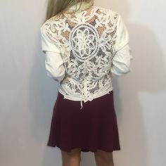 Ivory Open Crochet Floral Blazer Jacket Ivory colored blazer/dress jacket. Floral cut out/open crochet design on back. Rosettes on the front. It's a size 6 and a bit big on me. Looks better fitted! There's a tie in the back that can be removed or adjusted. 60% acetate, 40% rayon. Trim is 100% cotton. Made in USA. Gently worn, in good condition!  ↠NO trades please Wild Rose Jackets & Coats