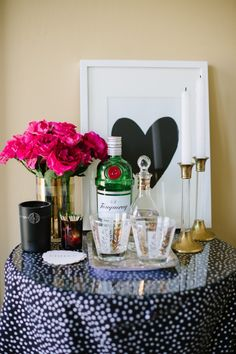 The Side Table: The most minimalist option is creating a mini-bar area on a side table in your living or dining room. Use a small table to display your favorite pair of glasses, a bottle of liquor, a fragrant candle and fresh flowers!