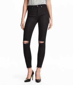 Jeans in washed stretch denim with ultra-slim legs. High waist, front and back pockets, and heavily distressed details.