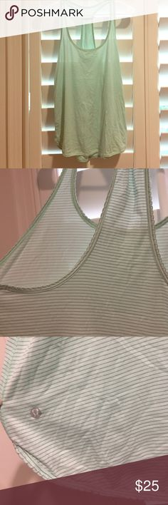 Lululemon Tank Top. Lululemon Tank Top. Mint green with subtle light gray stripes. Racerback. Loose fit. Adorable scalloped edges. Excellent condition, barely worn. Size 4. lululemon athletica Tops Tank Tops
