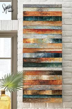 With its curved plank design and mixed media mingling of wood and metal, Odiana offers a uniquely three-dimensional take on modern art. Multitude of hand-painted shades make for a magnificent blend. #AshleyFurniture - Wall Art & Décor - Home Accessories - Signature Design by Ashley - Ashley Furniture