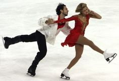 Benjamin Agosto and Tanith Belbin skate in the pair's ice dance final at the Skate America figure skating competition in Everett, Wash.