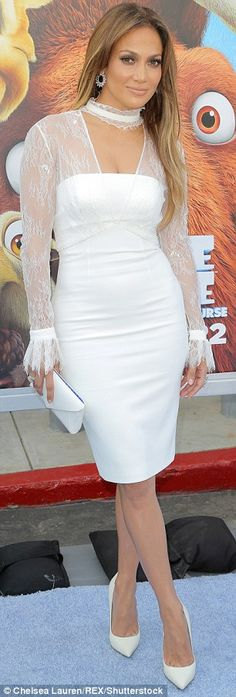 Getting it white:The 46-year-old stunner looked youthful in a white dress that had a shee...