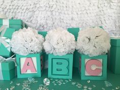 Set of 3. Perfect for guest tables at your baby shower, these baby block centerpieces measure 5x5 with a flowers ball (takes height to 11inches). Choose from blue and white, blue white and pink, all b