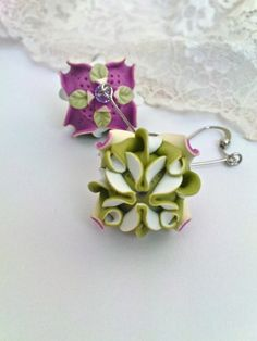 Russian artist Zuzana Liptáková uses folded polymer clay for these magenta and sage green floral earrings. As seen on The Polymer Arts magazine's blog.  www.thepolymerarts.com