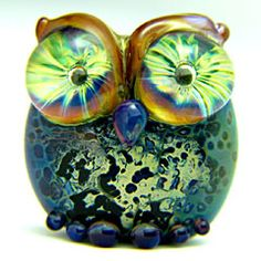 I found this web page with tons of these amazing glass owl beads. They inspire me!