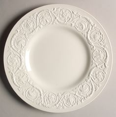 """""""Patrician"""" china pattern with white embossed lace accents on rim & scroll flourishes from Wedgwood."""