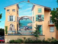 The French artistPatrick Commecyhasspecialized in the creation ofarchitectural trompe-l'œil, turning blank walls into beautiful scenes of life, packe