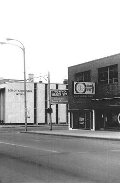 The corner of Harrison and East Second Street, Flint, Michigan, 1982. I drive down there all the time. I had forgotten about these businesses.