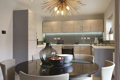 The open-plan dining room and kitchen. #Strata