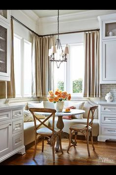 Love the eating nook with cabinets and storage on both sides