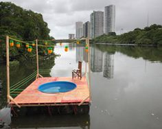 the 'praia' workshop floats swimming pool along polluted capibaribe river in recife