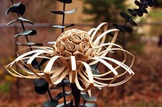 Make a paper flower from recycled cardboard tubes. This is an economical paper craft as well as a way to recycle and be good to Mother Earth.