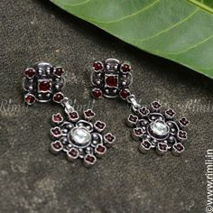A simple & casual earrings in silver tone with pinkish red beads. Drop in by our store at T.Nagar, Chennai for more designs (on prior appointment basis). Whatsapp your queries to +91 9841640771