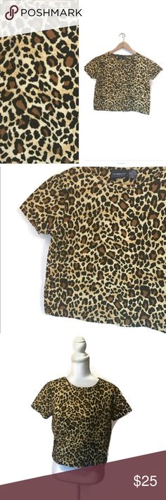 """Vintage 90s leopard crop top Total bad ass stretchy leopard print crop top. Peg Bundy style!!!! Wear it with black stretchy leggings for a 90s rock n roll vibe.  In good vintage condition. Circa 1990s.  designer- liz claiborne 100% cotton marked size - womens M  M E A S U R E M E N T S are taken with garments laying flat,  across seam to seam....they are NOT doubled.  shoulder to shoulder -15 """" pit to pit -17"""" top to bottom-17"""" Liz Claiborne Tops Crop Tops"""
