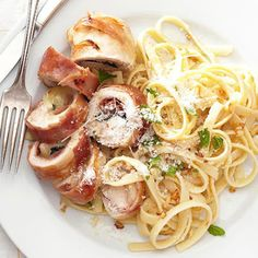A weeknight dinner of chicken breast medallions filled with prosciutto, mozzarella, and fresh basil, and served on top of fettuccine in a butter and garlic sauce.